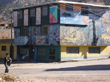 The mural painted on two sides of the Museo de Memoria to honor the victims of a genocide in Peru in the 1980s-early 2000s. There are mutilated limbs, fire, and children.