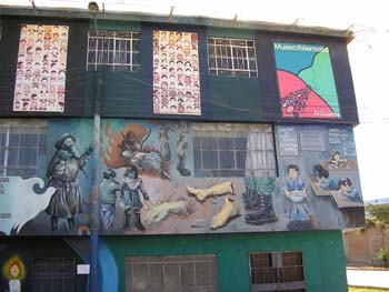 The mural painted on the Museo de Memoria to honor the victims of a genocide in Peru in the 1980s-early 2000s. There are mutilated limbs, fire, and children.